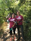 Cutting down invasive trees with a coworker during the United Way Day of Caring
